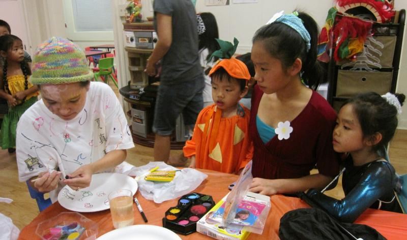 Parents and siblings help at our Halloween party